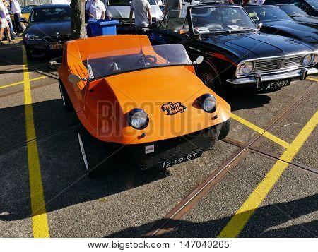 Amsterdam, The Netherlands - September 10, 2016: Orange Barclay Mini Bug Stimson 1967 On Display Dur