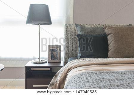 Black Modern Lamp On Wooden Table Side In Modern Bedroom