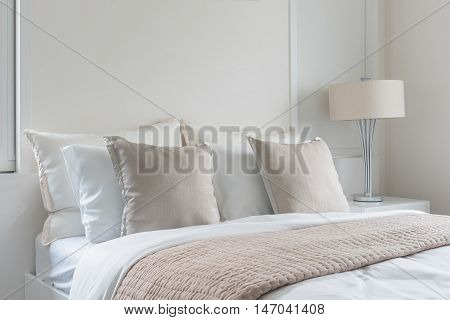 Modern Lamp On Table Side With Picture Frame On Wall In Bedroom