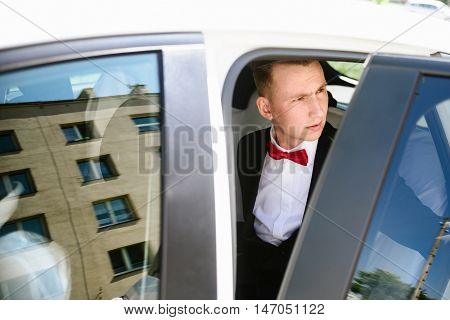 Groom Getting Out The Wedding Car