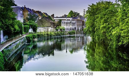 GENT (Ghent), BELGIUM - MAY 12, 2016: The north flowing Lys (Leie) River converges with the Scheldt River in Gent and continues north to empty into the North Sea. In recent years tourism is becoming more popular on Gent's waterways with riverboat cruises