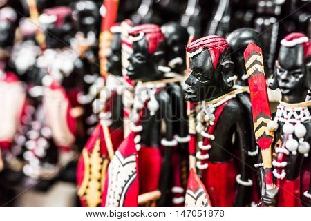 beautiful national tribal wooden ebony figures Masai at Zanzibar market, Africa