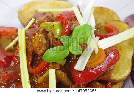 stew with potatoes and vegetables on plate
