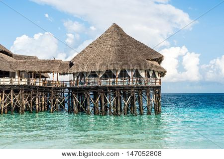 colorful landscape with african hotel in sea on the pier, Zanzibar