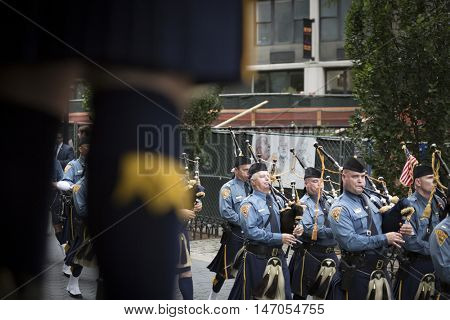 NEW YORK-SEPT 9 2016: NJ State Police Pipes and Drums perform in the NYPD Emerald Society Pipe and Drums 9/11 Memorial Procession on the 15th anniversary of the terror attack.