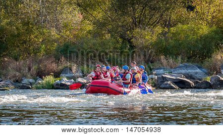 Village Myhiya Nikolaev region Ukraine - September 10 2016: Rafting on the Southern Bug River. An experienced instructor holds the key to a great adventure. Rafting in Ukraine. Fun, risky, bold action.