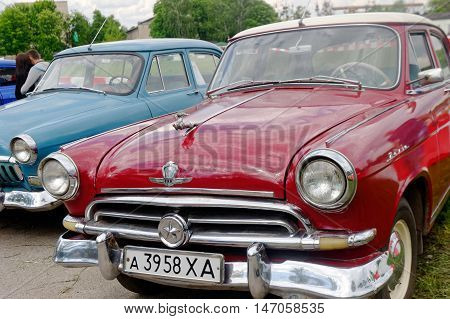 Kharkiv Ukraine - May 22 2016: Soviet retro car cherry-blossom sedan GAZ M21 Volga First Series manufactured between 1956 and 1958 exhibited at the festival of vintage cars Kharkiv Retro Rally - 2016 in Kharkiv Ukraine on May 22 2016