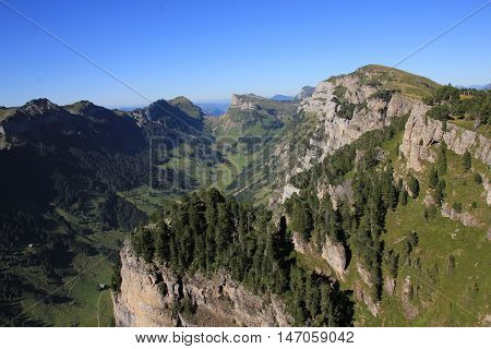View from Mt Niederhorn Swiss Alps. Justistal valley in the Bernese Oberland. High cliffs.