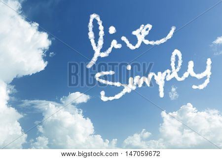 Live Simply written in the sky