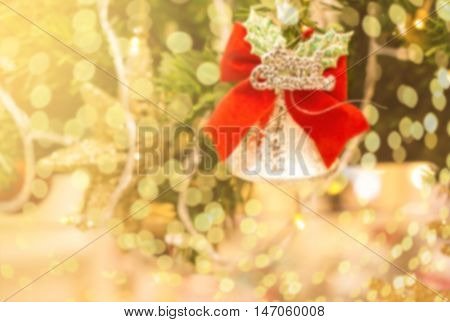 de-focused background and Bokeh lignt with The word MERRY CHRISTMAS on traditional tree decorations