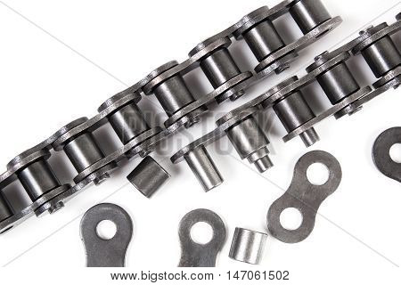 Industrial driving roller chain on white background. Machinery and Engineering