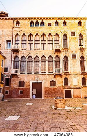 Bright colored house in Venetian style in San Beneto square in Venice in the evening. Campo San Beneto. Italy