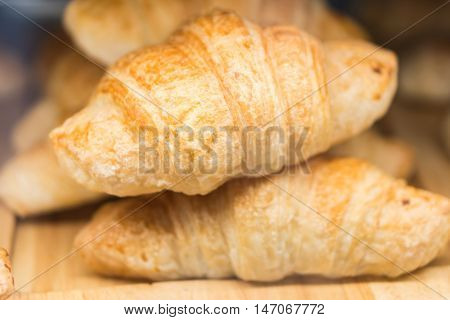 The Tasty croissants on grey wooden background