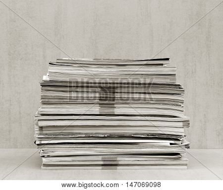 a large stack of magazines close-up front view. black and white photo