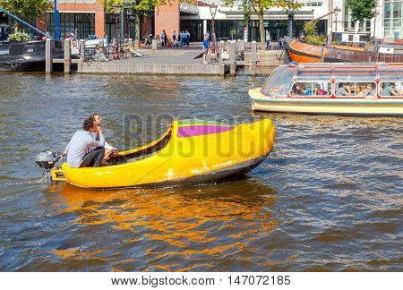 Amsterdam Netherlands - August 26 2016: Excursions by boat on the canals of Amsterdam. Favorite place for walking and leisure travelers.