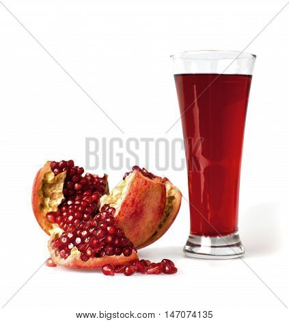 Glass of freshly squeezed pomegranate juice with a pomegranate next to it