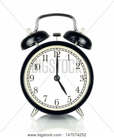 Alarm Clock isolated on white in black and white showing five o'clock.
