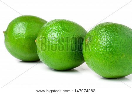 three lime isolated on white background close up.