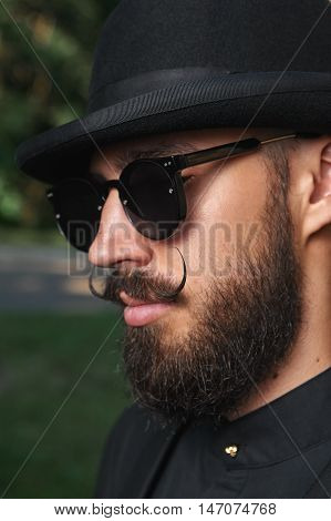 Bearded Man with Bowler Hat, Suit and Sunglasses