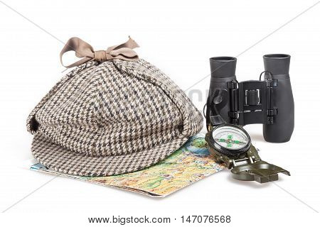Black binoculars, Sherlock Holmes hat, map and compass Isolated on White Background