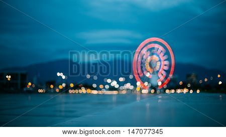 Batumi Georgia. Abstract Motion Blur Image Of Brightly Red Illuminated Ferris Wheel In Miracle Park, Amusement City Park On Blue Evening Sky, Bokeh Boke Background.