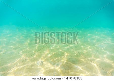 Under water image Shallow Seabed with sunlight reflection