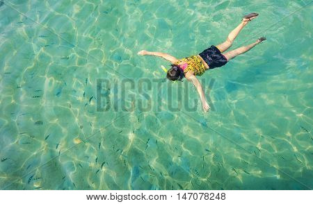 Skin diving or snokerling at shallow of beach