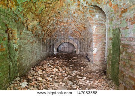 Ruins inside fort Tarakanovskiy. Destroyed building. Brick arch. Old stone tunnel leads to dungeon. Casemates . Dubno. Ukraine.