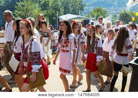 4 September 2016. Rakhiv Transcarpathian region Ukraine. Celebration - Festival Hutsul brynza . Colorful procession - parade of people dressed in national costumes. Children continue national traditions