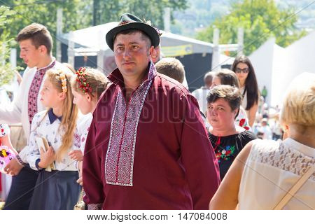 4 September 2016. RakhivTranscarpathian region Ukraine. Celebration - Festival Hutsul brynza. Colorful procession - parade of people dressed in national costumes. Preservation of traditions and crafts manufacturing of cheese a national food and drinks.