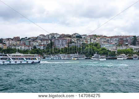 ISTANBUL TURKEY - JUNE 25 2015: Ferries are passing Bosphorus from Asia to Europe in Istanbul Turkey