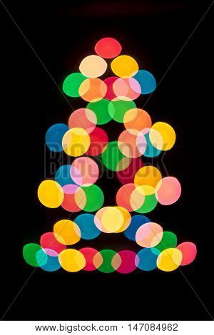 Decorative multi colour balls. Decorative multicolour Christmas tree. Blue, orange, green, white and red bubbles