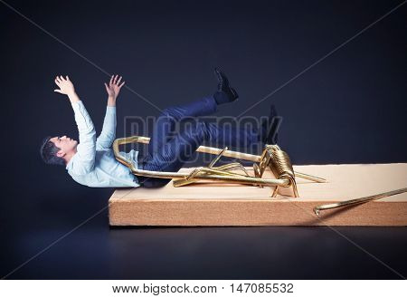 Businessman in the mouse-trap