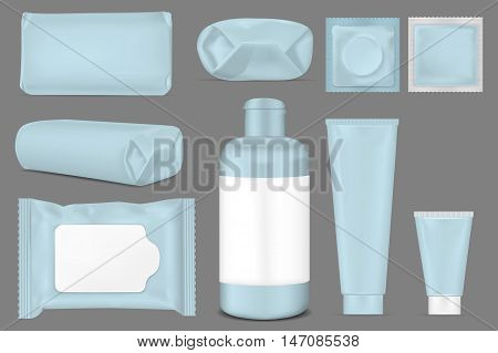 Big set. Blue empty plastic packaging for fashion cosmetics hygiene. Blank foil sachet.
