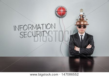 Information security text with vintage businessman and alert light