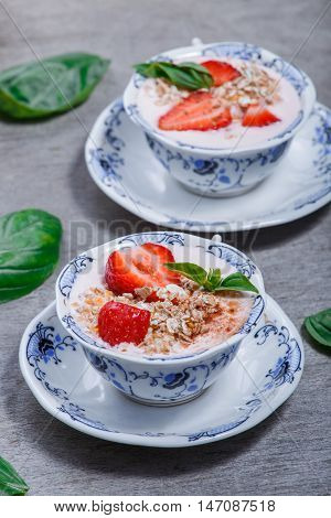 Granola, Muesli With Strawberries And Yogurt Decorate With Mint