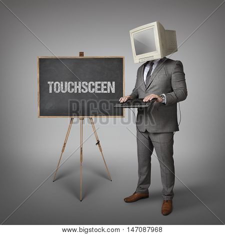 Touchsceen text on blackboard and computer monitor on businessman head