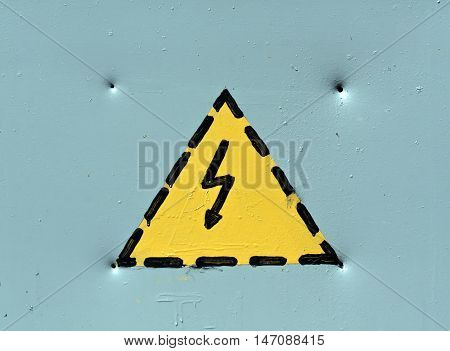 Electric Emergency Warning Sign On Grey Metal Sureface.