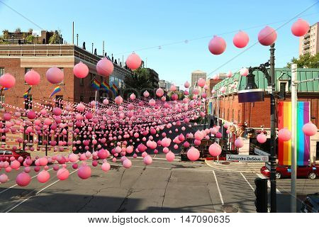 Montreal, Quebec, Canada - August 23, 2016: Pink balls is an annual installation that takes place during the Montreal summer in the Gay area.