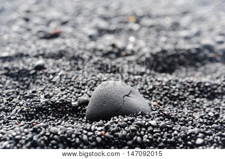 Closeup of black pebble on the black sand, Reynisfjara, Iceland