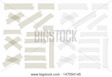 Pieces of different size, gray sticky, adhesive masking tape are on white background.