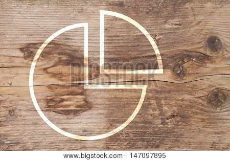Illustration of pie chart on brown wooden background