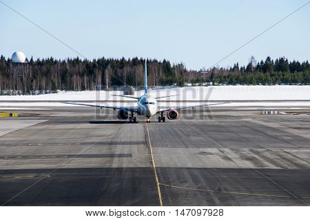 Airplane taking off airport  runway in winter