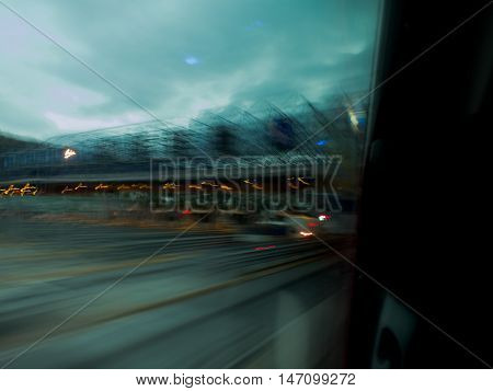Approaching a toll station with a moving bus just before sunrise.