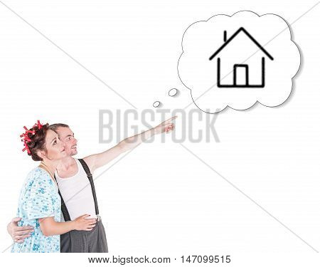 Funny Family Couple Embracing And Pointing On Dream House