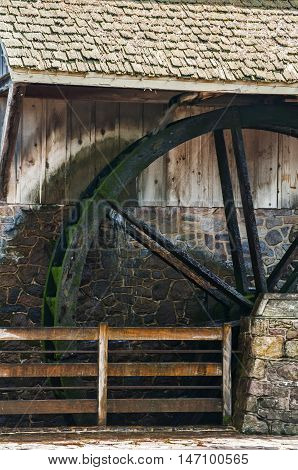 Wooden wheel of old water mill closeup