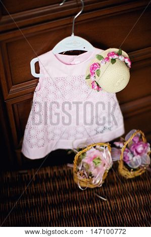 Pink dress and straw hat for a little girl. Top view