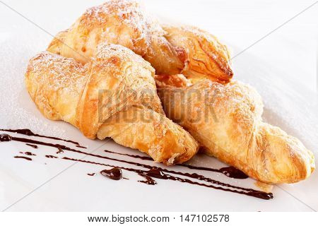 croissants on white plate isolated on the white background.