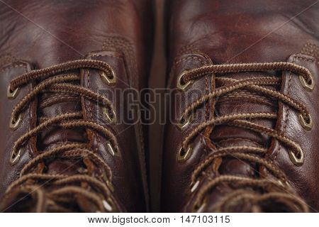 The old leather shoes and shoelaces shot closeup