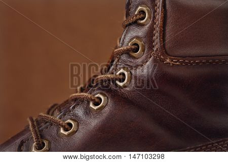 Old leather brown shoes and shoelaces shot closeup